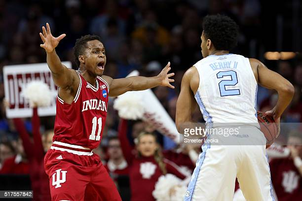 Yogi Ferrell of the Indiana Hoosiers defends Joel Berry II of the North Carolina Tar Heels in the first half during the 2016 NCAA Men's Basketball...