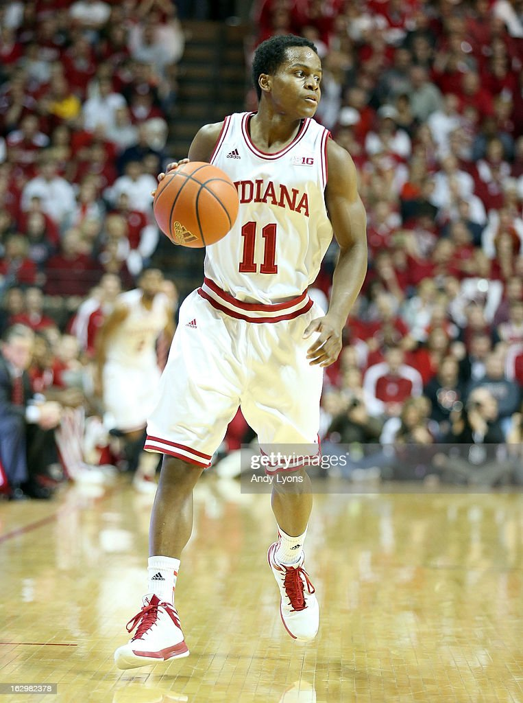 Yogi Ferrell #11 of the Indiana Hoosiers dribbles the ball during the game against the Iowa Hawkeyes at Assembly Hall on March 2, 2013 in Bloomington, Indiana.