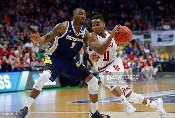Yogi Ferrell of the Indiana Hoosiers drives against Justin Tuoyo of the Chattanooga Mocs in the first half during the first round of the 2016 NCAA...