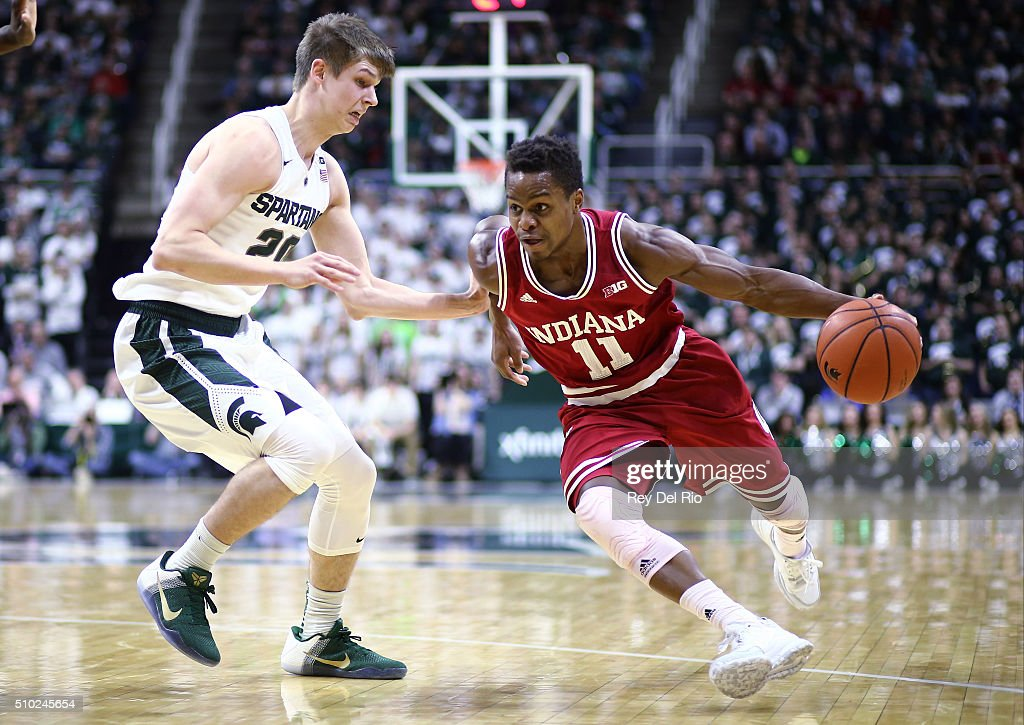 <a gi-track='captionPersonalityLinkClicked' href=/galleries/search?phrase=Yogi+Ferrell&family=editorial&specificpeople=8023910 ng-click='$event.stopPropagation()'>Yogi Ferrell</a> #11 of the Indiana Hoosiers drives around against Matt McQuaid #20 of the Michigan State Spartans in the first half at the Breslin Center on February 14, 2016 in East Lansing, Michigan.