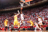 Yogi Ferrell of the Indiana Hoosiers drives to the basket against the Maryland Terrapins in the first half of the game at Assembly Hall on March 6...