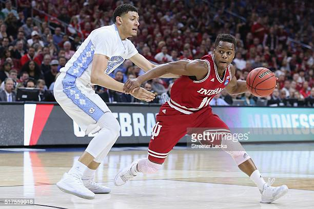 Yogi Ferrell of the Indiana Hoosiers drives to the basket in the first half against Justin Jackson of the North Carolina Tar Heels during the 2016...