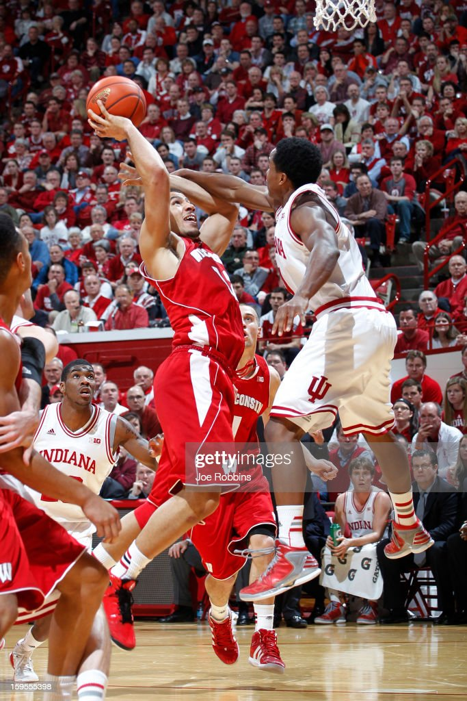 Yogi Ferrell #11 of the Indiana Hoosiers fouls Traevon Jackson #12 of the Wisconsin Badgers during the game at Assembly Hall on January 15, 2013 in Bloomington, Indiana. Wisconsin defeated Indiana 64-59.