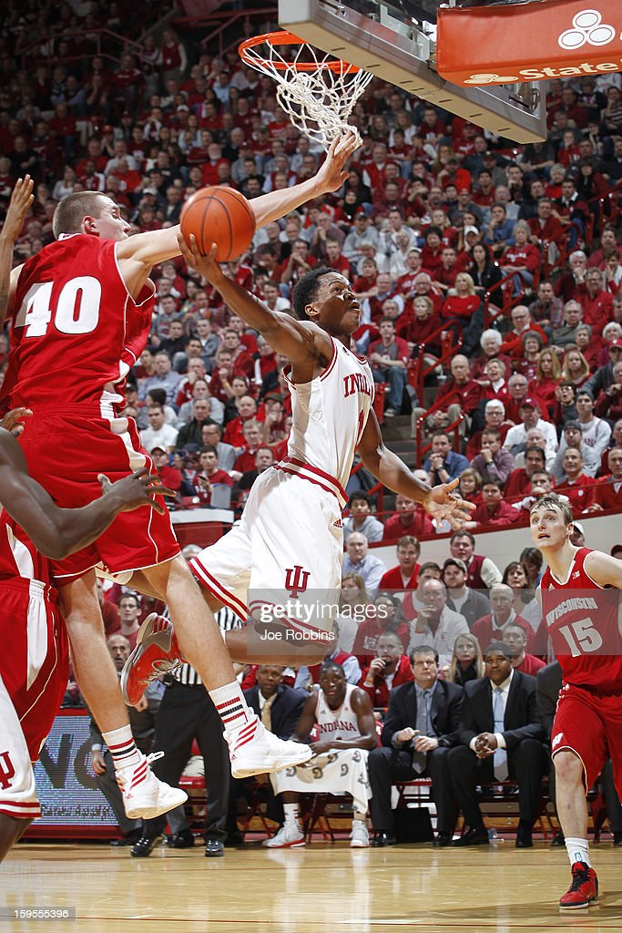 Yogi Ferrell #11 of the Indiana Hoosiers gets fouled under the basket by Jared Berggren #40 of the Wisconsin Badgers during the game at Assembly Hall on January 15, 2013 in Bloomington, Indiana. Wisconsin defeated Indiana 64-59.