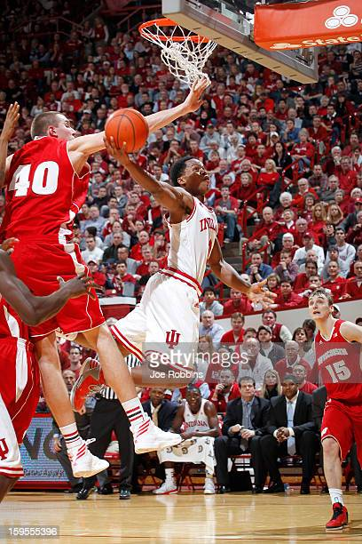 Yogi Ferrell of the Indiana Hoosiers gets fouled under the basket by Jared Berggren of the Wisconsin Badgers during the game at Assembly Hall on...