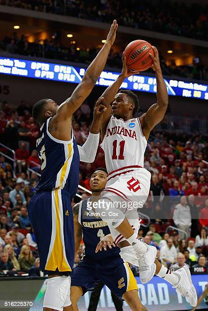 Yogi Ferrell of the Indiana Hoosiers goes up for a shot against Justin Tuoyo of the Chattanooga Mocs in the first half during the first round of the...