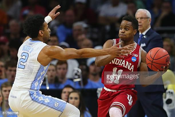 Yogi Ferrell of the Indiana Hoosiers looks to pass against Joel Berry II of the North Carolina Tar Heels during the 2016 NCAA Men's Basketball...