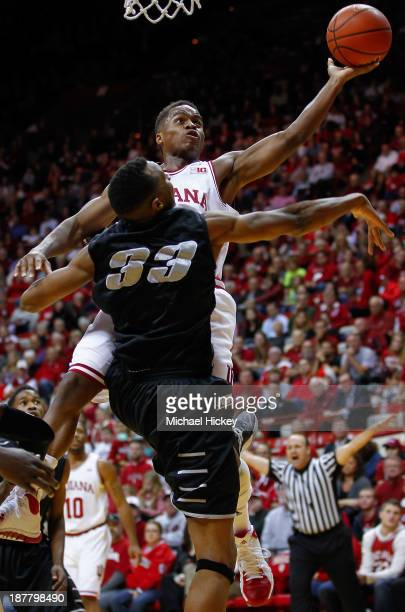 Yogi Ferrell of the Indiana Hoosiers shoots the ball against EJ Reed of the Long Island Blackbirds at Assembly Hall on November 12 2013 in...