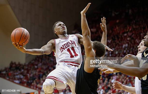 Yogi Ferrell of the Indiana Hoosiers shoots the ball against PJ Thompson of the Purdue Boilermakers at Assembly Hall on February 20 2016 in...