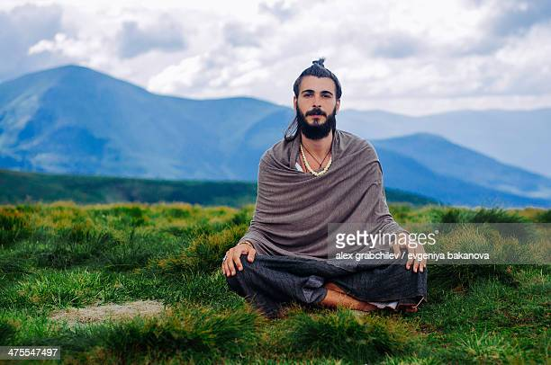 yogi meditating in mountains, Ukraine
