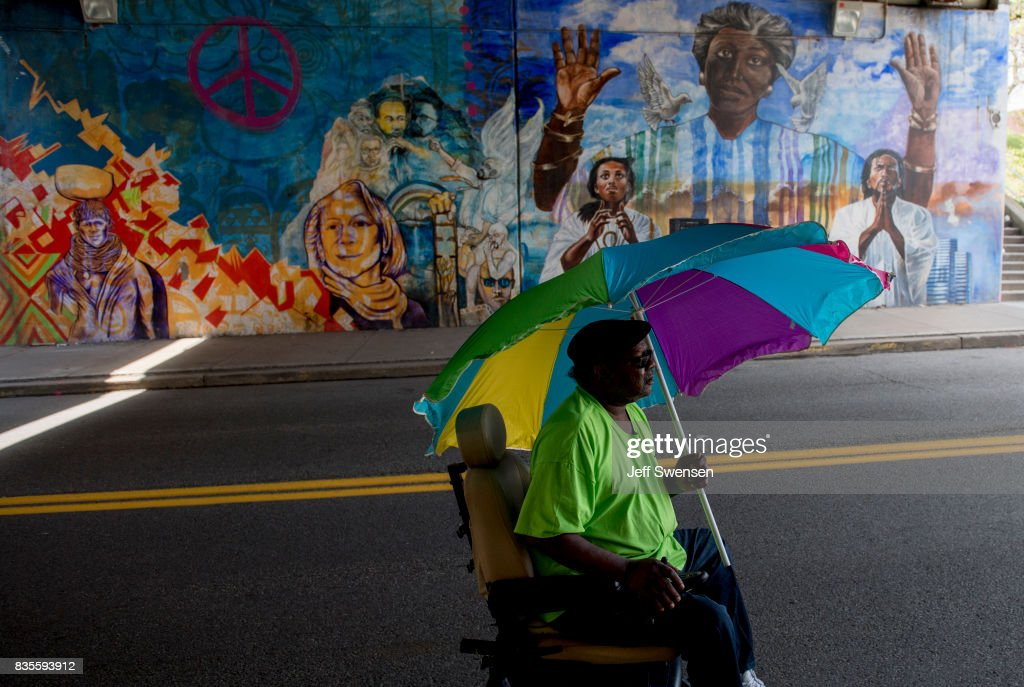 Yogi Stephens, 62, heads home after participating in a protest march through the Homewood neighborhood during their Black Brilliance Collective: March and Gathering August 19, 2017 in Pittsburgh, Pennsylvania. Just one week after the violent 'Unite the Right' rally in Virginia that left one woman dead and dozens more injured people have come out in solidarity with Charlottesville and to protect their neighborhoods.