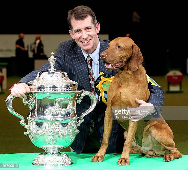Yogi the Hungarian Vizsla and handler John Thirwell celebrate after winning 'Best in Show' at the 2010 Crufts dog show on March 14 2010 in Birmingham...