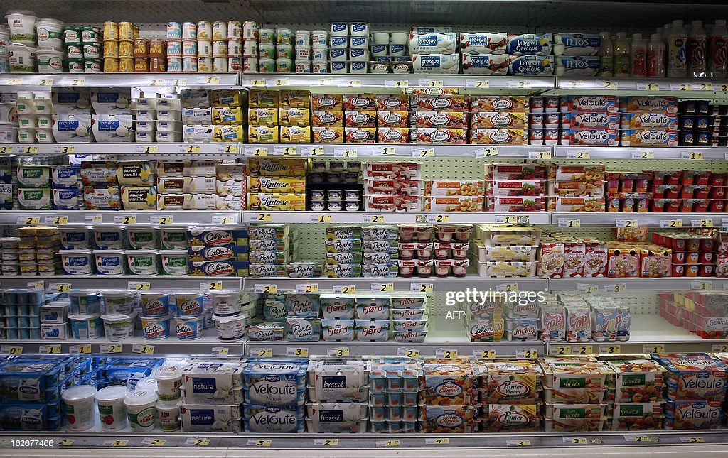 Yogurts are displayed at a supermarket in Herouville Saint-Clair, northwestern France, on February 26, 2013. AFP PHOTO/CHARLY TRIBALLEAU.