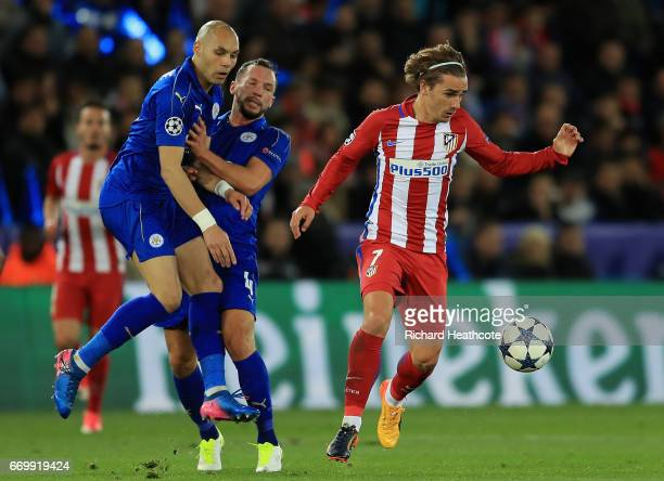 Yohan Benalouane of Leicester City and Danny Drinkwater of Leicester City colide as they attempt to put pressure on Antoine Griezmann of Atletico...