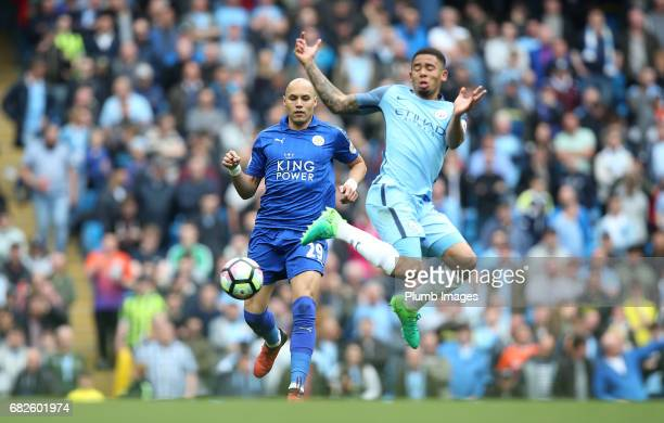 Yohan Benalouane of Leicester City in action with Gabriel Jesus of Manchester City during the Premier League match between Manchester City and...