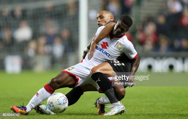 Yohan Benalouane of Leicester City in action with Kieran Agard of MK Dons during the pre season friendly between MK Dons and Leicester City on July...