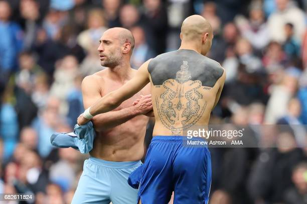 Yohan Benalouane of Leicester City shakes hands with Pablo Zabaleta of Manchester City at the end of the Premier League match between Manchester City...
