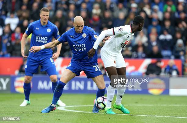 Yohan Benalouane of Leicester in action with M'Baye Niang of Watford during of the Premier League match between Leicester City and Watford at King...