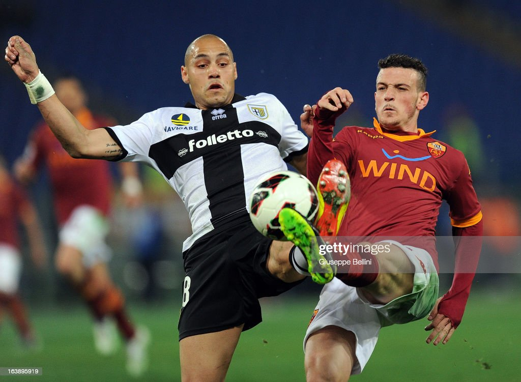 Yohan Benalouane of Parma and Alessandro Florenzi of Roma in action during the Serie A match between AS Roma and Parma FC at Stadio Olimpico on March 17, 2013 in Rome, Italy.