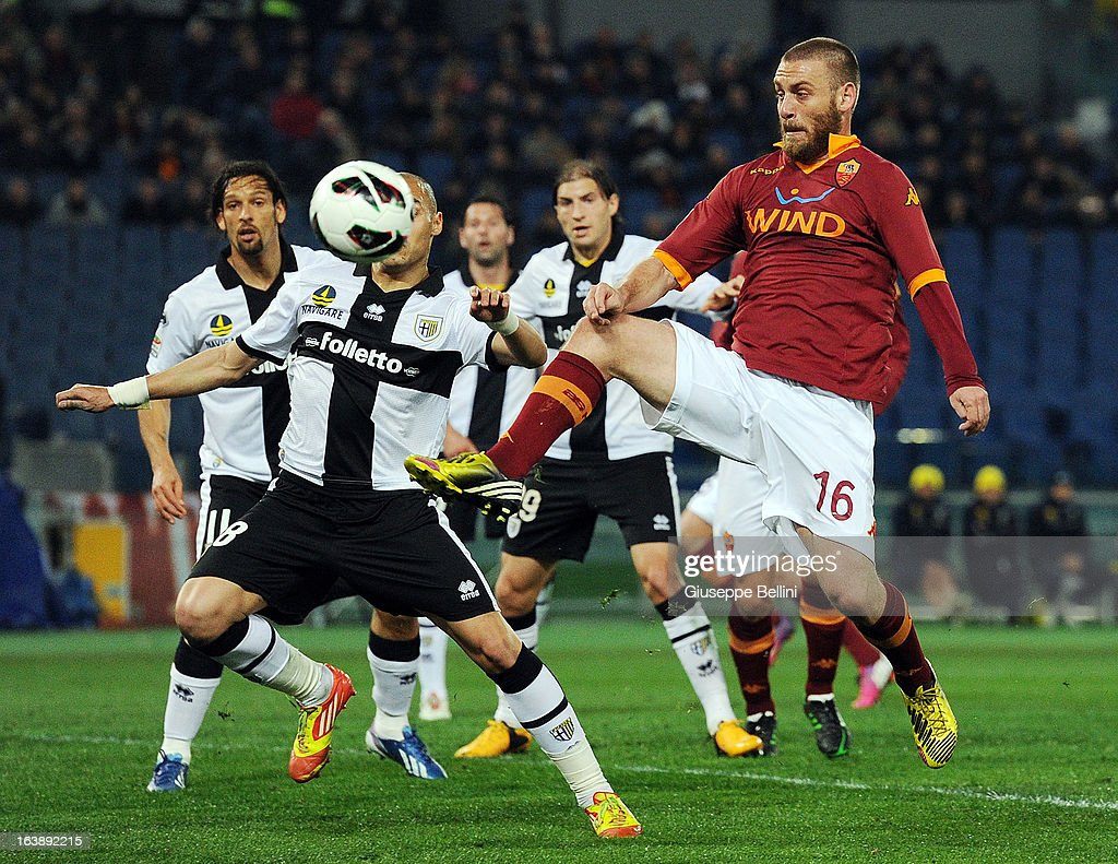 Yohan Benalouane of Parma and <a gi-track='captionPersonalityLinkClicked' href=/galleries/search?phrase=Daniele+De+Rossi&family=editorial&specificpeople=233652 ng-click='$event.stopPropagation()'>Daniele De Rossi</a> of Roma in action during the Serie A match between AS Roma and Parma FC at Stadio Olimpico on March 17, 2013 in Rome, Italy.