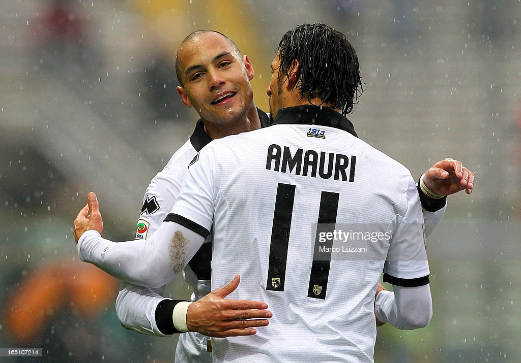 Yohan Benalouane (L) of Parma FC celebrates with his team-mate <a gi-track='captionPersonalityLinkClicked' href=/galleries/search?phrase=Amauri+Carvalho+De+Oliveira&family=editorial&specificpeople=2089638 ng-click='$event.stopPropagation()'>Amauri Carvalho De Oliveira</a> (R) after scoring during the Serie A match between Parma FC and Pescara at Stadio Ennio Tardini on March 30, 2013 in Parma, Italy.