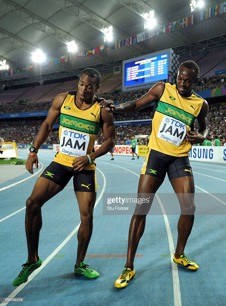 Yohan Blake and Usain Bolt of Jamaica celebrate victory and a new world record in the men's 4x100 metres relay final during day nine of 13th IAAF World Athletics Championships at Daegu Stadium on September 4, 2011 in Daegu, South Korea.