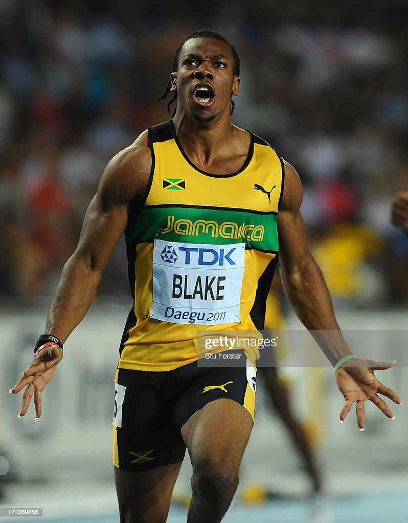 <a gi-track='captionPersonalityLinkClicked' href=/galleries/search?phrase=Yohan+Blake&family=editorial&specificpeople=2172755 ng-click='$event.stopPropagation()'>Yohan Blake</a> (L) of Jamaica celebrates winning the men's 100 metres final during day two of the 13th IAAF World Athletics Championships at the Daegu Stadium on August 28, 2011 in Daegu, South Korea.