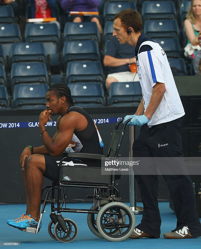 <a gi-track='captionPersonalityLinkClicked' href=/galleries/search?phrase=Yohan+Blake&family=editorial&specificpeople=2172755 ng-click='$event.stopPropagation()'>Yohan Blake</a> of Jamaica is wheeled off in a wheelchair, after pulling up in the Mens 100m Final with a hamstring injury during day one of the Diamond League Sainsbury's Glasgow Grand Prix at Hampden Park on July 11, 2014 in Glasgow, Scotland.