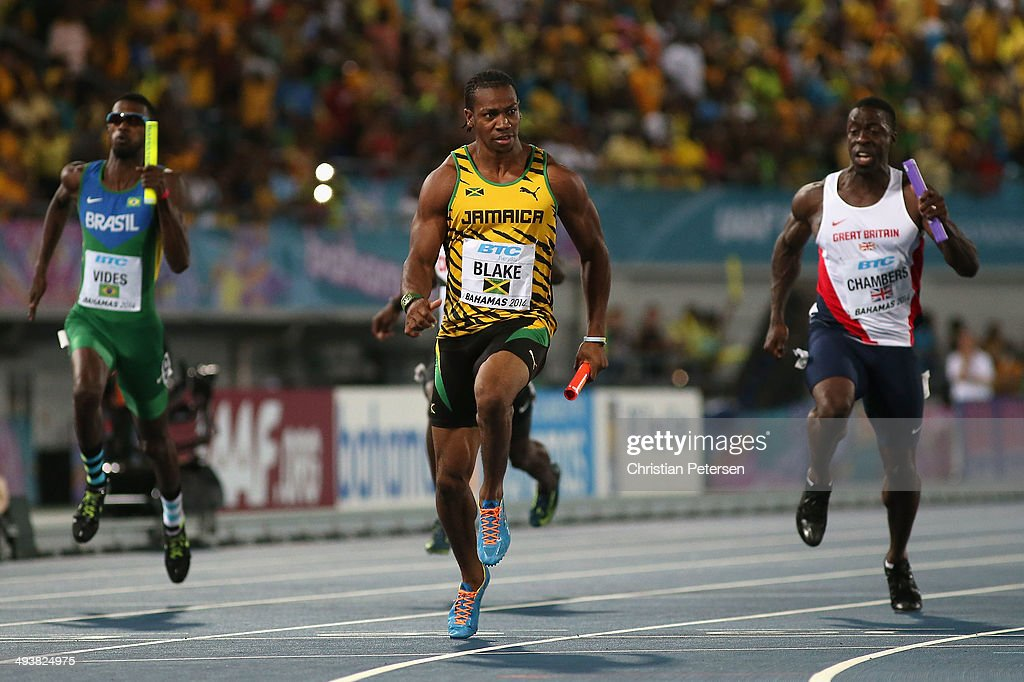 <a gi-track='captionPersonalityLinkClicked' href=/galleries/search?phrase=Yohan+Blake&family=editorial&specificpeople=2172755 ng-click='$event.stopPropagation()'>Yohan Blake</a> (C) of Jamaica of crosses the finish line ahead of <a gi-track='captionPersonalityLinkClicked' href=/galleries/search?phrase=Dwain+Chambers&family=editorial&specificpeople=215102 ng-click='$event.stopPropagation()'>Dwain Chambers</a> (R) of Great Britain to win the Men's 4x100 metres relay final during day two of the IAAF World Relays at the Thomas Robinson Stadium on May 25, 2014 in Nassau, Bahamas.