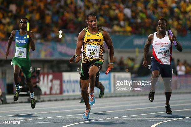 Yohan Blake of Jamaica of crosses the finish line ahead of Dwain Chambers of Great Britain to win the Men's 4x100 metres relay final during day two...