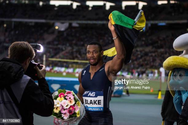 Yohan Blake of Jamaica waves a flag after the men's 100m during the AG Insurance Memorial Van Damme as part of the IAAF Diamond League 2017 at King...