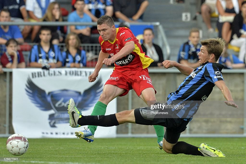 Yohan Brouckaert of KV Oostende battles for the ball with Brandon Mechele of Club Brugge during the Jupiler Pro League match between KV Oostende and Club Brugge KV on August 4, 2013 in Oostende, Belgium. (Photo by Peter De Voecht/Photonews