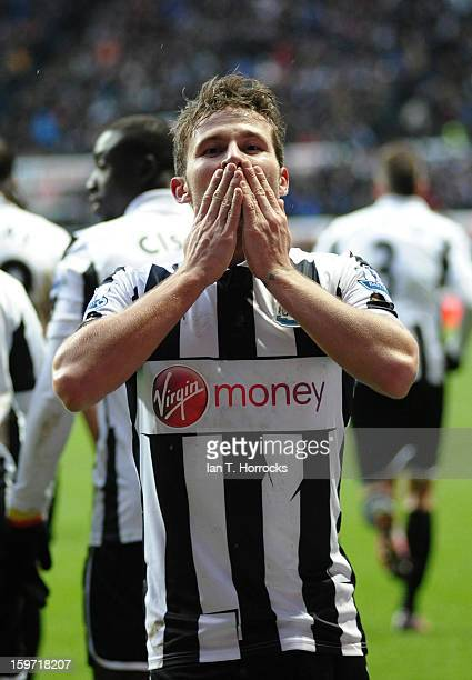 Yohan Cabaye celebrates scoring the opening goal during the Barclays Premier League match between Newcastle United and Reading at St James' Park on...