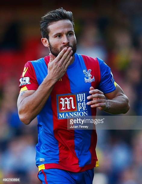 Yohan Cabaye of Crystal Palace celebrates as he scores their first goal from a penalty during the Barclays Premier League match between Watford and...
