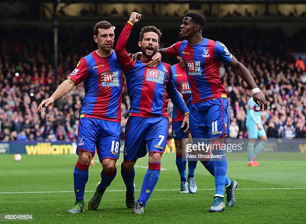 Yohan Cabaye of Crystal Palace celebrates scoring his team's first goal with his team mates James McArthur and Wilfried Zaha during the Barclays...