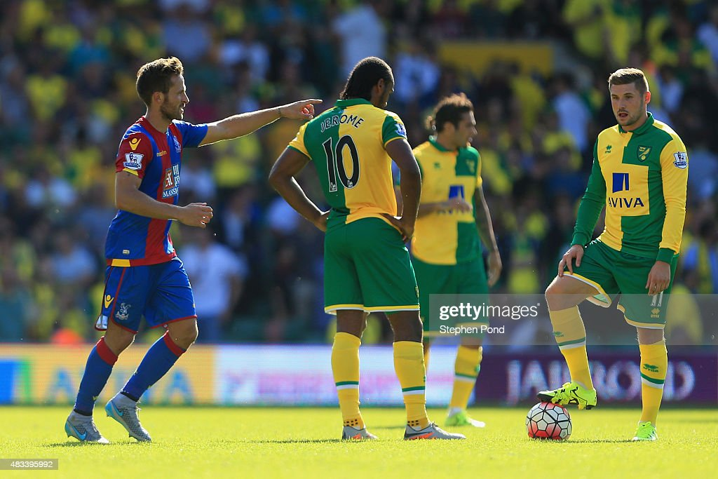 Yohan Cabaye of Crystal Palace celebrates scoring his team's third goal while Cameron Jerome and Gary Hooper of Norwich City show their frustration...