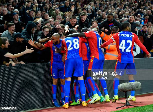 Yohan Cabaye of Crystal Palace is mobbed by team mates as he celebrates scoring their second goal during the Premier League match between Crystal...