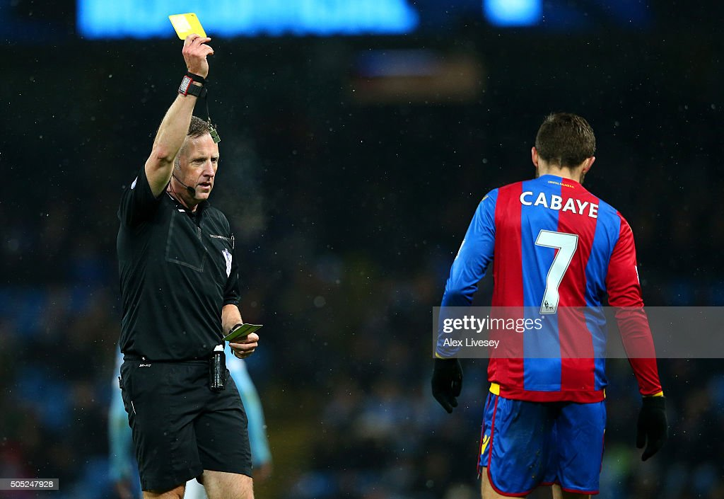 <a gi-track='captionPersonalityLinkClicked' href=/galleries/search?phrase=Yohan+Cabaye&family=editorial&specificpeople=648909 ng-click='$event.stopPropagation()'>Yohan Cabaye</a> of Crystal Palace receives a yellow card from referee <a gi-track='captionPersonalityLinkClicked' href=/galleries/search?phrase=Jonathan+Moss+-+Arbitro+di+calcio&family=editorial&specificpeople=14630509 ng-click='$event.stopPropagation()'>Jonathan Moss</a> during the Barclays Premier League match between Manchester City and Crystal Palace at Etihad Stadium on January 16, 2016 in Manchester, England.