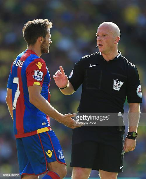 Yohan Cabaye of Crystal Palace talks with referee Simon Hooper during the Barclays Premier League match between Norwich City and Crystal Palace at...