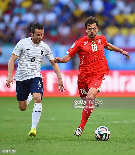 Yohan Cabaye of France and Admir Mehmedi of Switzerland compete for the ball during the 2014 FIFA World Cup Brazil Group E match between Switzerland...