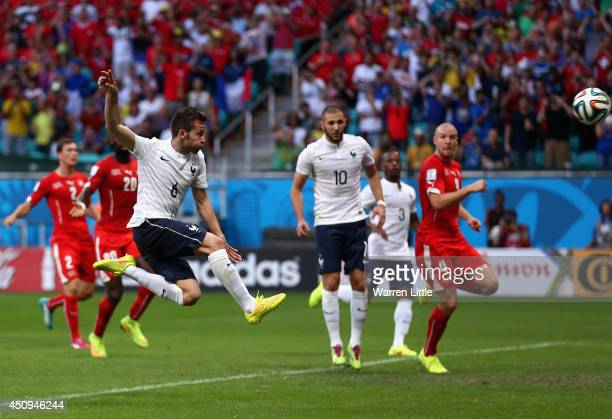 Yohan Cabaye of France hits a rebound from a penalty save during the 2014 FIFA World Cup Brazil Group E match between Switzerland and France at Arena...