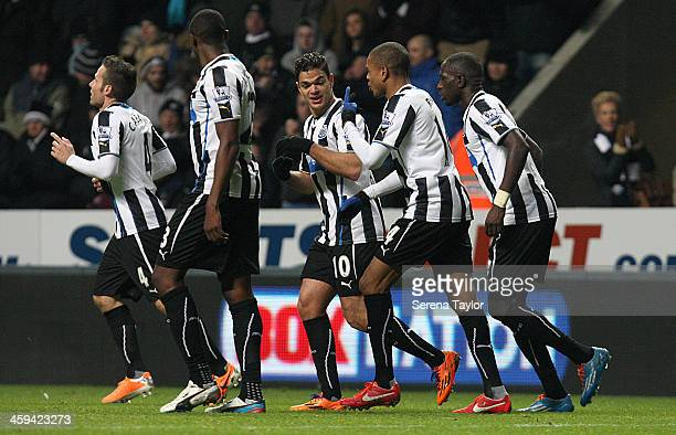 Yohan Cabaye of Newcastle celebrates with teammates Shola Ameobi Hatem Ben Arfa Loic Remy and Moussa Sissoko after scoring Newcastle's fourth goal...
