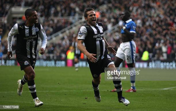 Yohan Cabaye of Newcastle United celebrates after scoring the first goal during the Barclays Premier League match between Newcastle United and Wigan...