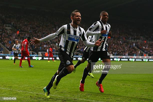 Yohan Cabaye of Newcastle United celebrates scoring their first goal with Loic Remy of Newcastle United during the Barclays Premier League match...