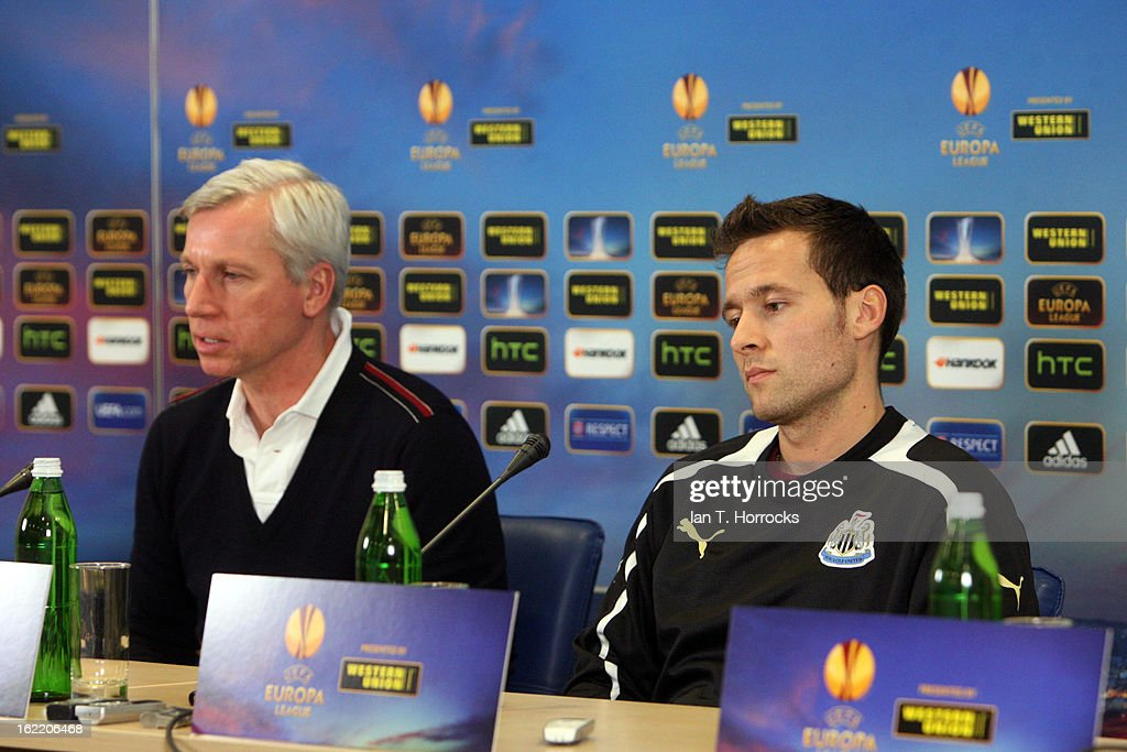 Yohan Cabaye of Newcastle United FC (R) listens as manager Alan Pardew speaks during a press conference ahead of their UEFA Europa League round of 32 second leg match against FC Metalist Kharkiv, at Metalist Stadium on February 20, 2013 in Kharkov, Ukraine.