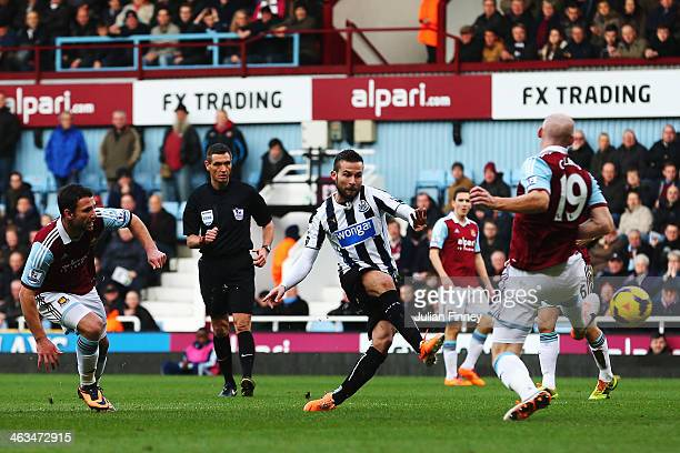 Yohan Cabaye of Newcastle United shoots and scores during the Barclays Premier League match between West Ham United and Newcastle United at the...