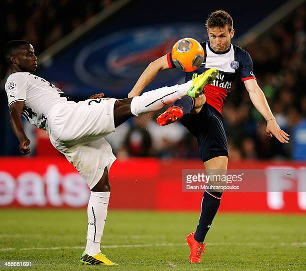 Yohan Cabaye of PSG and PaulGeorges Ntep de Madiba of Rennes battle for the ball during the Ligue 1 match between Paris SaintGermain FC and Stade...