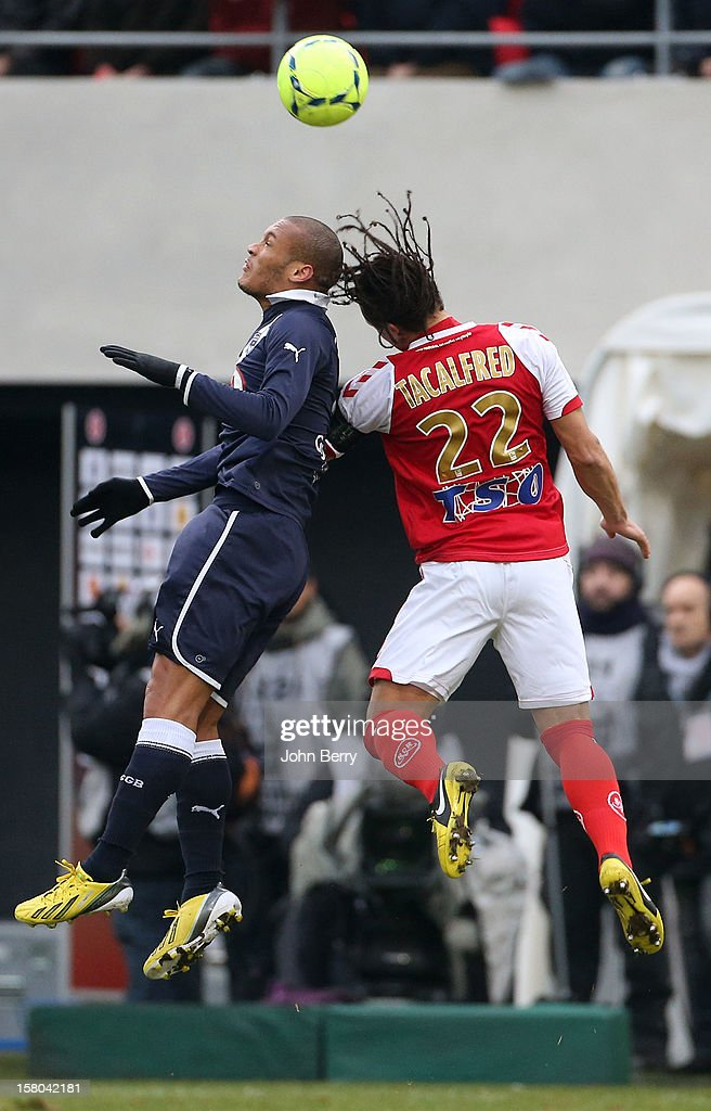 Yohan Gouffran of Bordeaux fights for the ball with Mickael Tacalfred of Reims during the French Ligue 1 match between Stade de Reims and Girondins de Bordeaux at the Stade Auguste Delaune on December 9, 2012 in Reims, France.