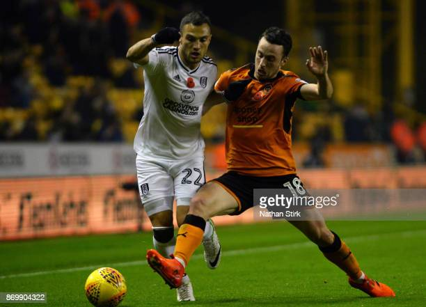 Yohan Mollo of Fulham and Diogo Jota of Wolverhampton Wanderers in action during the Sky Bet Championship match between Wolverhampton and Fulham at...