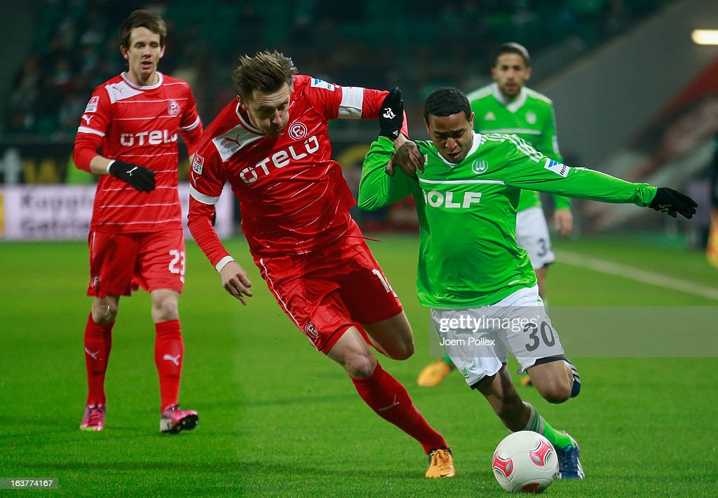 Yohandry Orozco (R) of Wolfsburg and <a gi-track='captionPersonalityLinkClicked' href=/galleries/search?phrase=Adam+Bodzek&family=editorial&specificpeople=764832 ng-click='$event.stopPropagation()'>Adam Bodzek</a> of Duesseldorf compete for the ball during the Bundesliga match between VfL Wolfsburg and Fortuna Duesseldorf 1895 at Volkswagen Arena on March 15, 2013 in Wolfsburg, Germany.